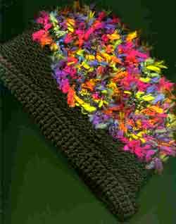 Black crocheted hat with multi-colored feather yarn
